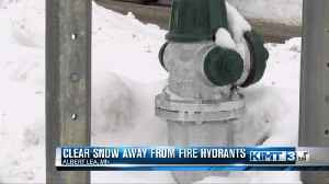 Firefighters reminding people to clear snow away from hydrants [Video]