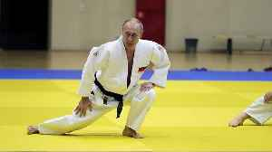 Black belt Putin shows off judo moves with Olympic athletes [Video]
