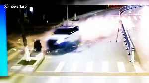 Man jogging on roadside has miraculous near miss from out-of-control car [Video]
