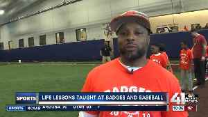 Officers teach life lessons through baseball [Video]