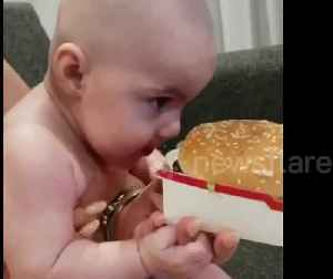 Baby stares hungrily at Big Mac during midnight feed [Video]