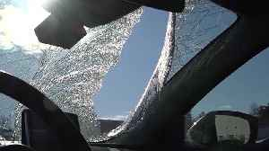 Six-year-old hurt when ice from truck flies through car's windshield [Video]
