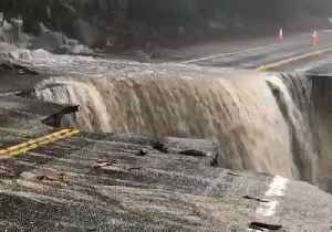 Surging Floodwater Opens Gaping Chasm in California Road [Video]