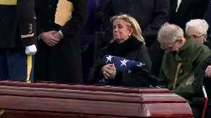 Rep. Debbie Dingell receives the flag from her late husband, John Dingell's casket [Video]
