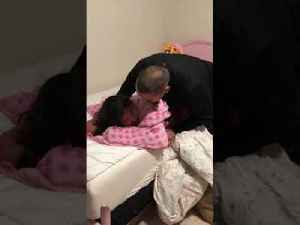 Military Dad Surprises Sleeping Daughter with Visit Home [Video]