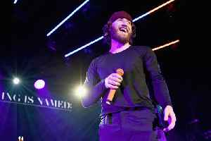 Mike Posner stays silent to preserve voice [Video]