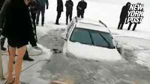 Family's car plunges into icy river after drifting 'for fun' [Video]
