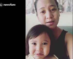 Baby girl gets emotional tears when listening to mum's singing [Video]