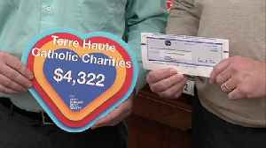 Kroger donated over $4,000 to Catholic Charities [Video]