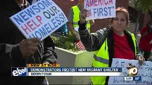 Homeless advocates protest new migrant shelter [Video]