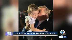 Local kids receive presidential kiss [Video]