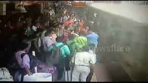 Police officers rush to save passengers who fell off moving train in Mumbai [Video]