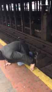 Drunk man and woman walk through nyc subway train tracks, very dangerous [Video]