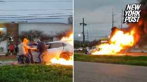 Brave bystanders save driver's life after fiery crash [Video]