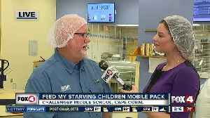 Feed My Starving Children holds mobile meal pack [Video]