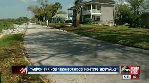 Neighbors in Tarpon Springs fight sidewalk construction [Video]