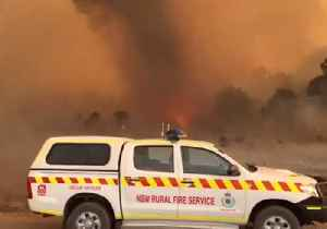 Close Shave for Firefighters as Fiery Twister Passes Nearby [Video]