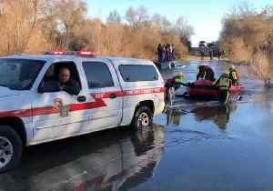 Firefighters Rescue Group Stranded on SUV in River [Video]