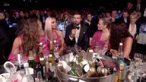 Little Mix Squirm As Jack Whitehall Brings Up Piers Morgan At Brits [Video]
