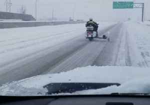 'Cruisin' Like it's No Big Deal': Motorcyclist Rides Through Snowstorm in Minnesota [Video]