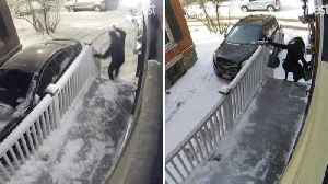 The Couple That Slips Together: Hilarious Moment Couple Both Slip On Same Icy Step Just Hours Apart [Video]