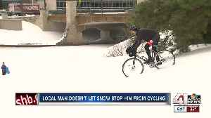 Local man doesn't let snow stop him from cycling [Video]