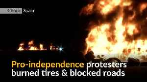 Catalan independence protesters burn tires and block roads in strike [Video]