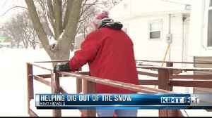 Helping dig out of the snow [Video]