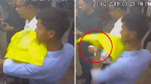 Thief stealing IPhone From Victim's Shirt Pocket [Video]