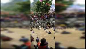 Thousands catch fish with bare hands at annual festival in China's Fujian [Video]