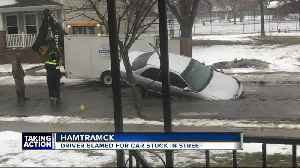 Viral photo of car in 'pothole' is from Hamtramck [Video]