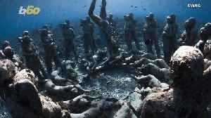 Incredible Photos Show Underwater Statues Created for Artificial Reef [Video]