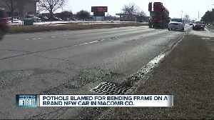 Pothole in Macomb County wrecks new car's suspension, bends frame [Video]