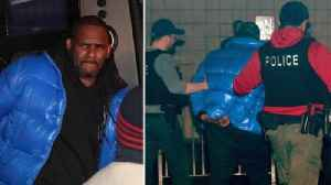 R Kelly hands himself in to police [Video]