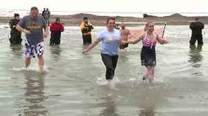 Special Olympics athletes take the plunge for a good cause [Video]
