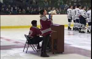 High school hockey player performs national anthem on piano in full uniform [Video]