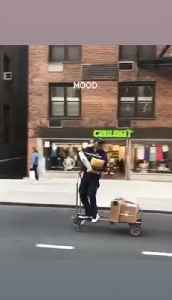 Courier Guy Cruises Through Street on Delivery Cart [Video]