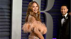 Chrissy Teigen Hilariously Pushed John Legend Out Of The Way So She Could Pose [Video]