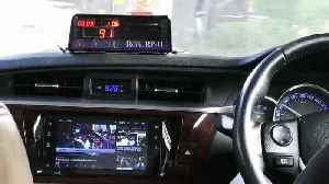 Bangkok taxi driver watches TV in his modified dashboard [Video]