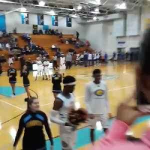 Basketball Player Gives Promposal to Girlfriend Before Game [Video]