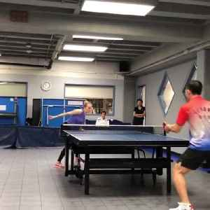 Female Table Tennis Player Spikes Ball with Backhand [Video]
