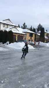 Weather Conditions Turn Street into Perfect Ice Rink [Video]