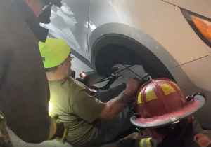 Firefighters Free Man Pinned Under Car After Suspension Gives Out [Video]