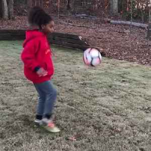 Little Girl Soccer Player Juggles Ball Between Legs [Video]