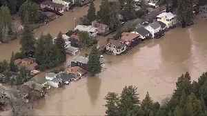 CA Russian River bursts its banks, prompts rescues [Video]