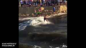 Aussie surfer enjoys riding rare waves in creek [Video]