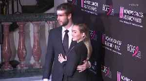 Miley Cyrus and Liam Hemsworth Couldn't Keep Their Hands Off Each Other on the Red Carpet [Video]