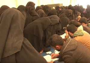Thousands of Women Who Lived Under Islamic State in Baghuz Arrive at Refugee Camp in Syria [Video]