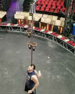 Juggler Balances Pole With Baskets on Head and Shoots Balls Inside [Video]