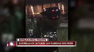 Surveillance video captures car plunging into river [Video]